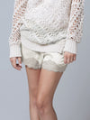 Model is wearing the Floral Lace Silk Shorts in white with an open knit white sweater.