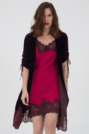 Model is wearing the Marilyn Lace Silk Slip Dress in fuchsia with burgundy lace and a burgundy velvet robe.