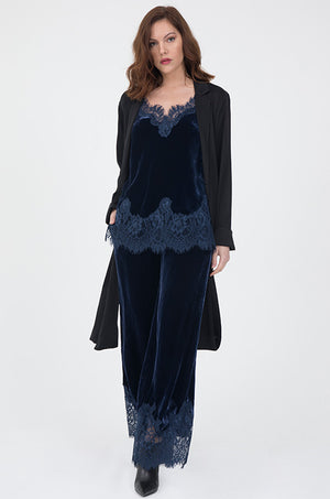 Model is wearing the Anastasia Lace Trim Velvet Cami in navy with Anastasia Lace Velvet Robe in navy and the Anastasia Lace Velvet Pants in navy. Also worn with black ankle high heel boots.