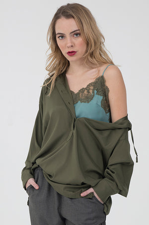 Model is wearing the Silk Hoodie Top in olive with the Marilyn Lace Silk Cami in oil blue with olive lace underneath. Also worn with the Menswear Plaid Pants in grey.