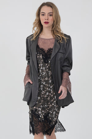 Model is wearing the Coco Print Silk Slip Dress with the All Over Lace Top in rose taupe underneath, and a pewter, silk PJ top worn unbuttoned with the sleeves cuffed.