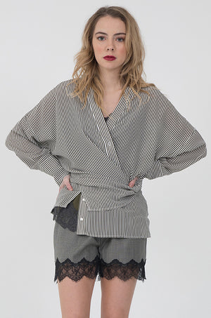 Model is wearing the Stripe Wedge Silk Shirt in black, with the Marilyn Lace Silk Cami in oil blue with olive lace, and the Menswear Plaid Shorts in grey.