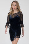 Model is wearing the Chantilly Lace Long Sleeve Top in black with the Velvet Ruched Dress in sapphire on top.
