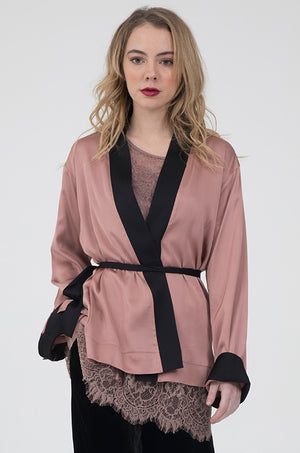 Model is wearing the Smock Wrap Shirt Kimono in rose with the All Over Lace Top in rose underneath, and the Anastasia Lace Velvet Pats in black.