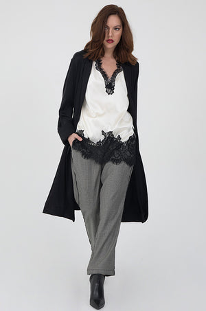 Model is wearing the Solid Long Sleeve Duster in black with the Megan Camisole in dove with black lace and the Menswear Plaid Pants in grey. Worn with black, high heel ankle boots.