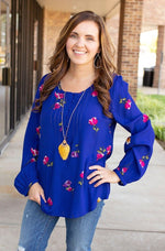 vibrant blue floral balloon sleeve top