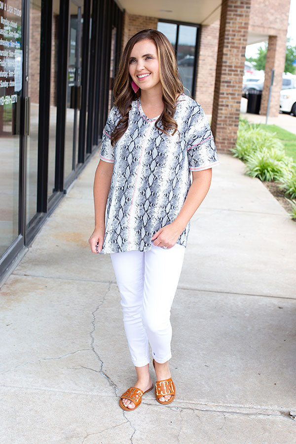 In Stitches Animal Print V-Neck Top