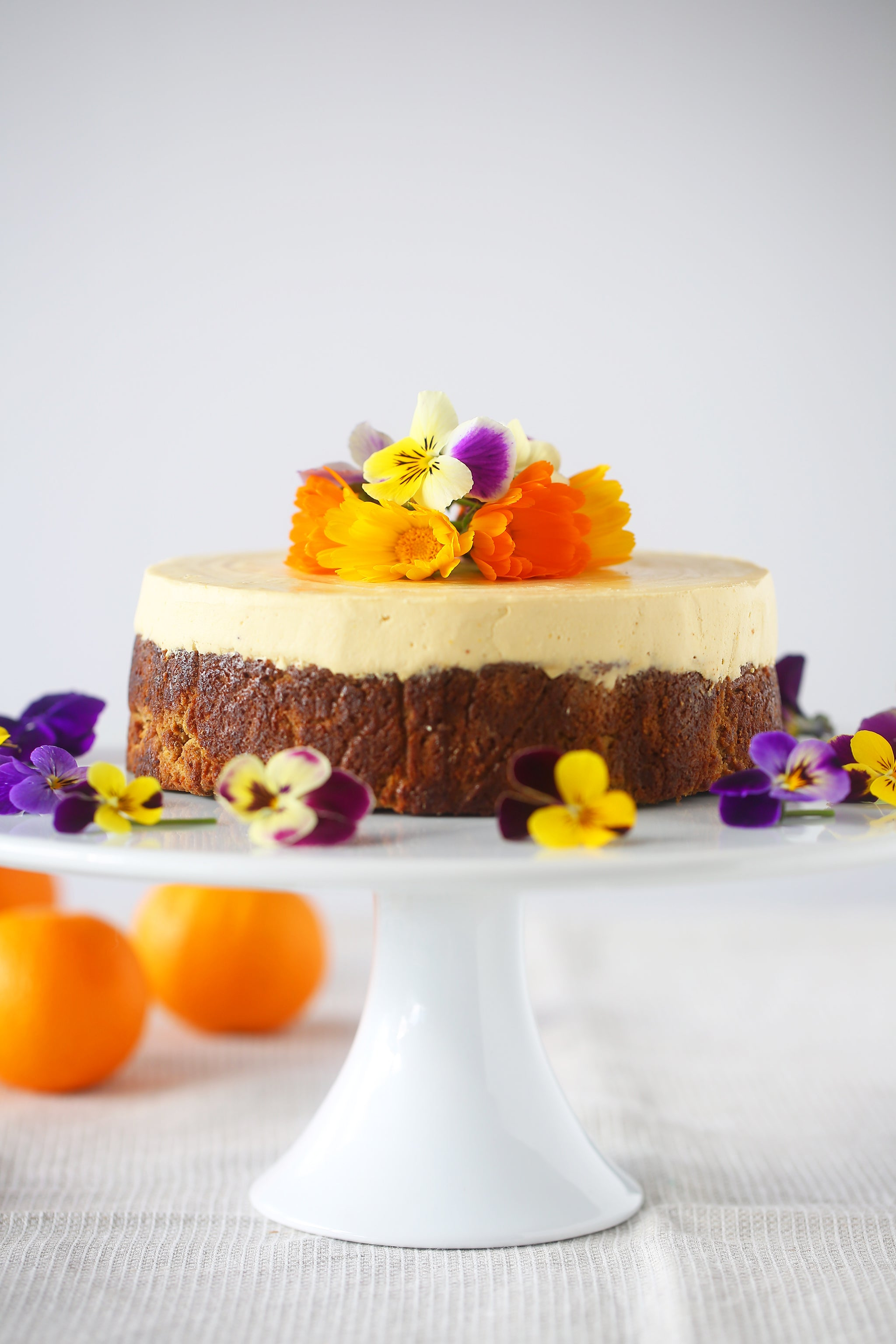 Decadently moist ORANGE, ALMOND AND COCONUT CAKE with the most incredible citrus cream chese icing - gluten free, refined sugar free, vegan, dairy free, egg free, begoodorganics