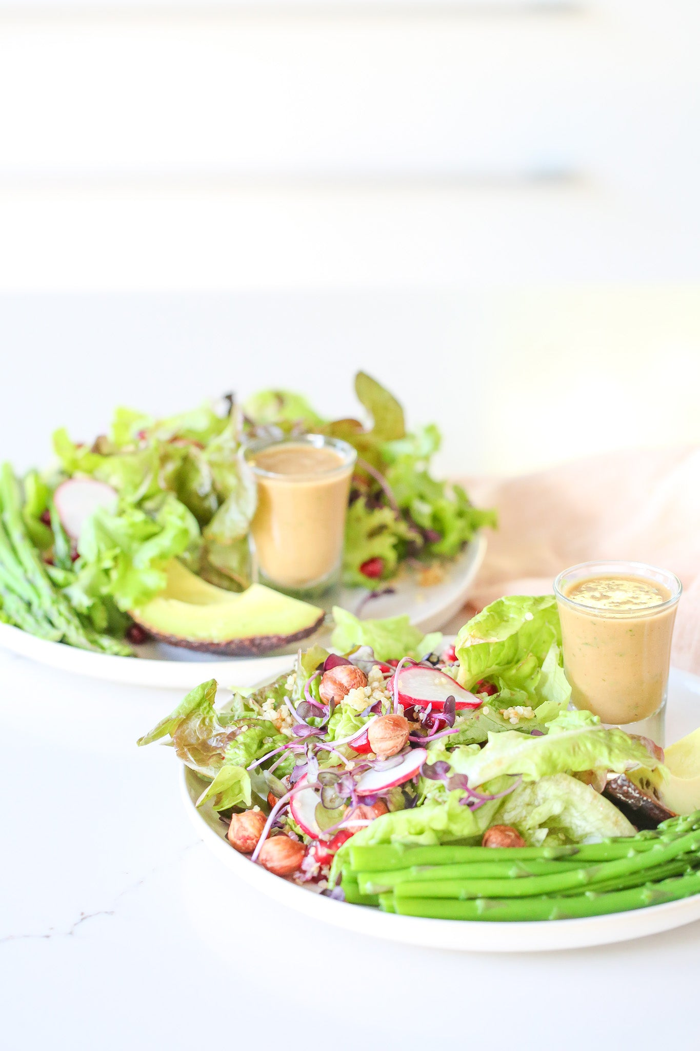 This salad is everything you love about summer – sweet pomegranate, fresh asparagus, creamy avo, crunchy hazelnuts, fluffy quinoa, all doused in the world's best balsamic vinaigrette. Vegan, gluten + dairy free.