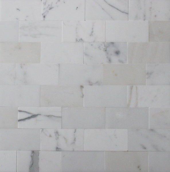 Calacatta honed subway tiles