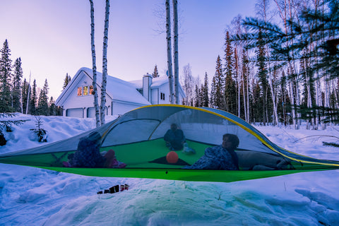Stingray tree Tent with kids in the snow with cabin in the background