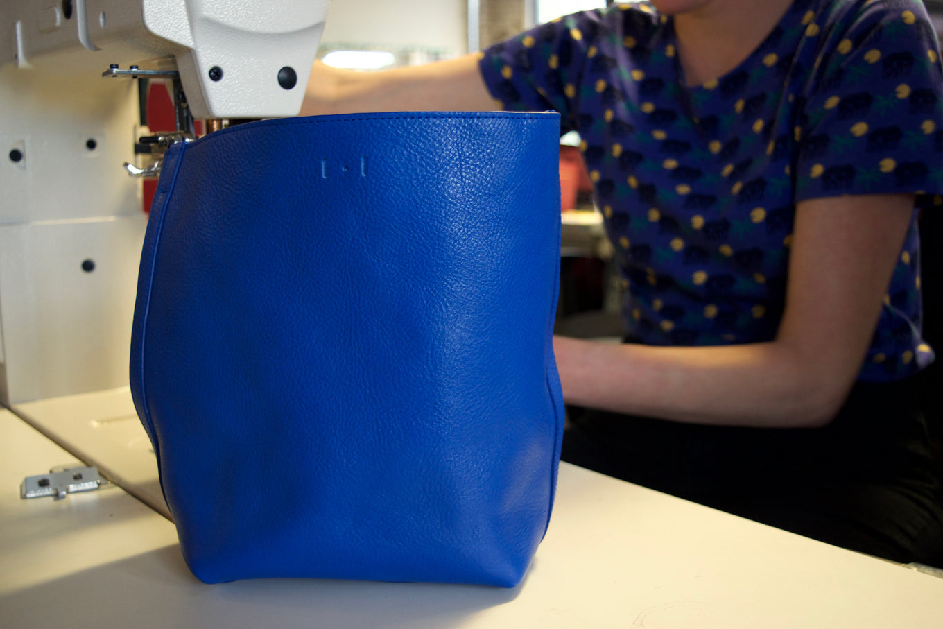 Lotuff Leather Mini Sling in electric blue