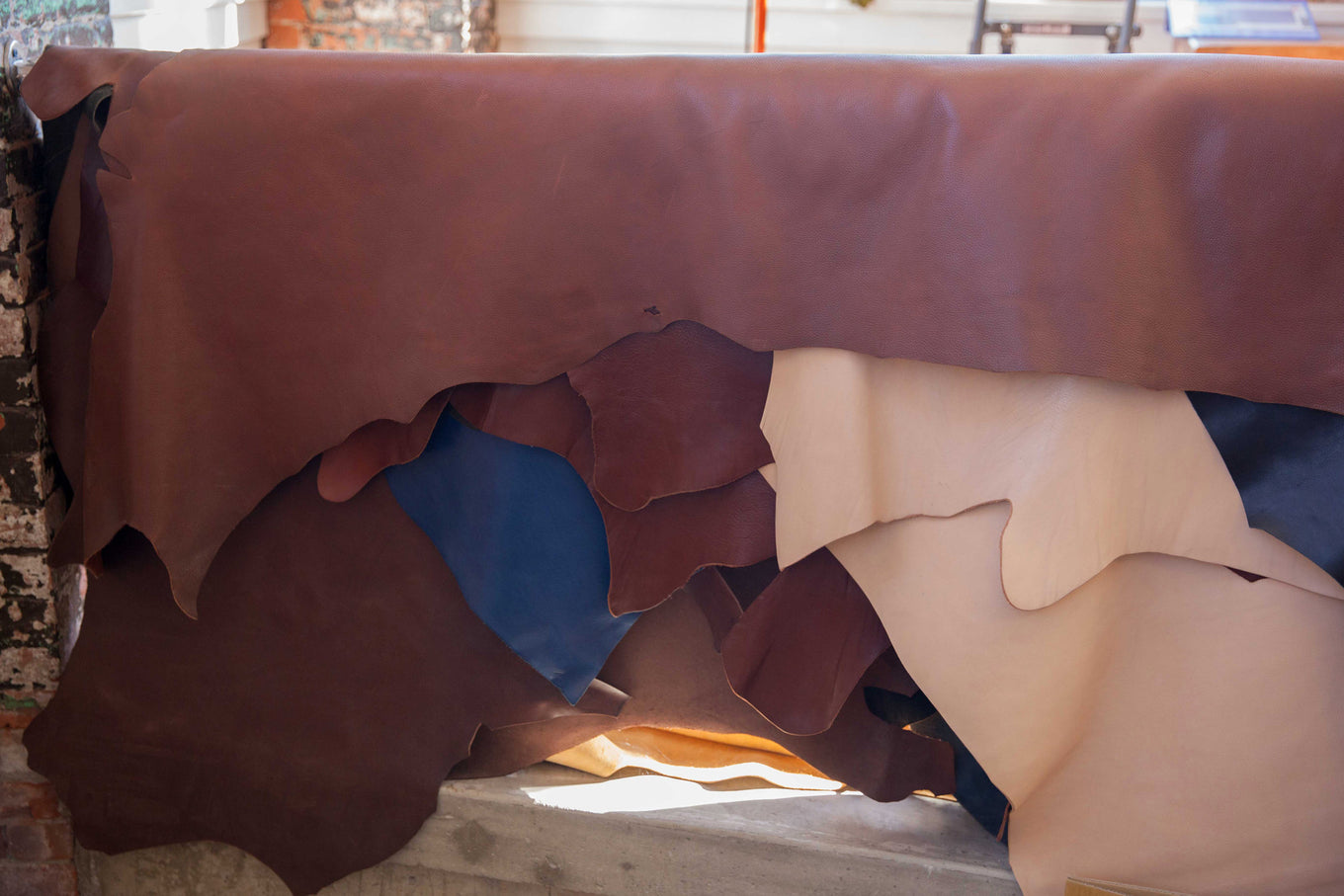 Full-grain leather hides at the Lotuff Leather design studio