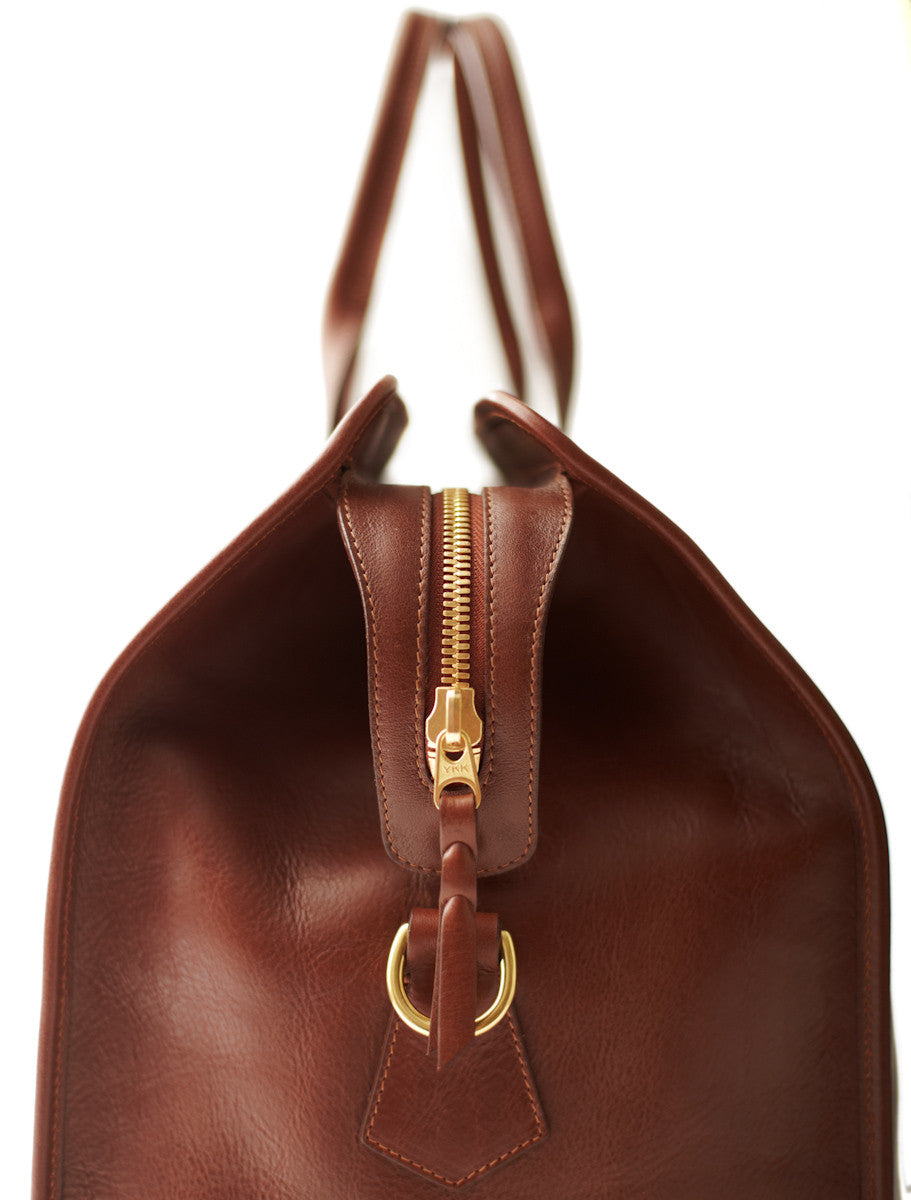 Side Leather View of Leather Trunk Duffle Bag Chestnut