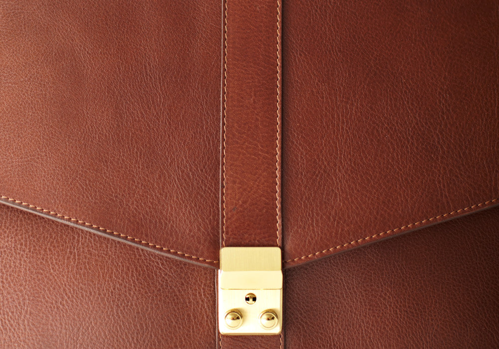 Front Lock of Leather Lock Briefcase Chestnut