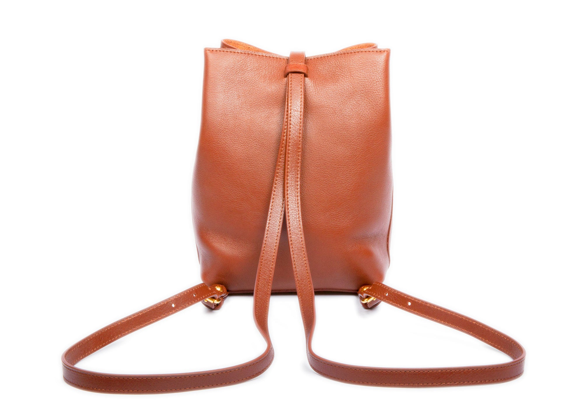 The Mini Sling Backpack Saddle Tan