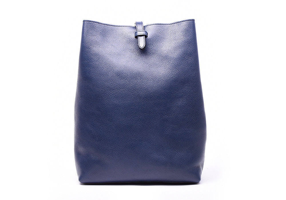 Front Leather View of The Sling Backpack Indigo