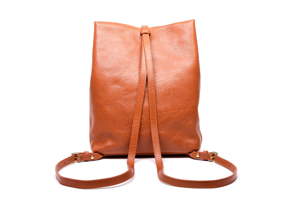 Back Leather Straps of The Sling Backpack Orange