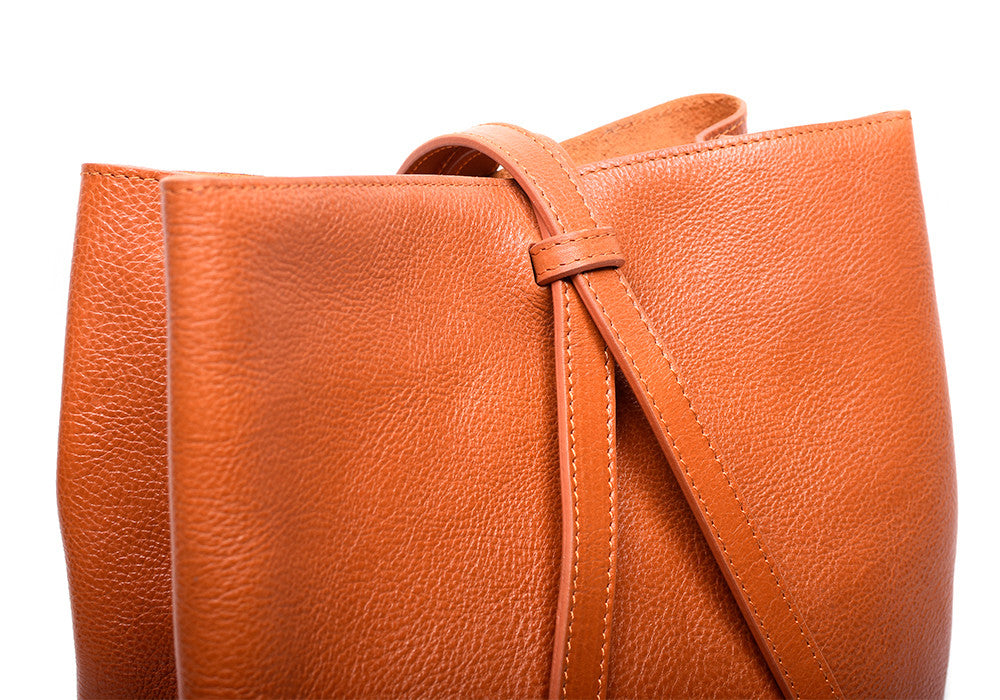 Leather Strap of The Sling Backpack Orange