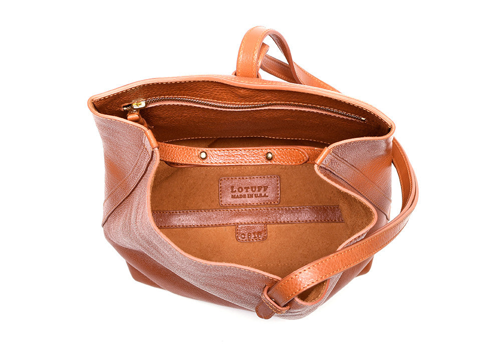 Inner Leather View of The Sling Backpack Orange
