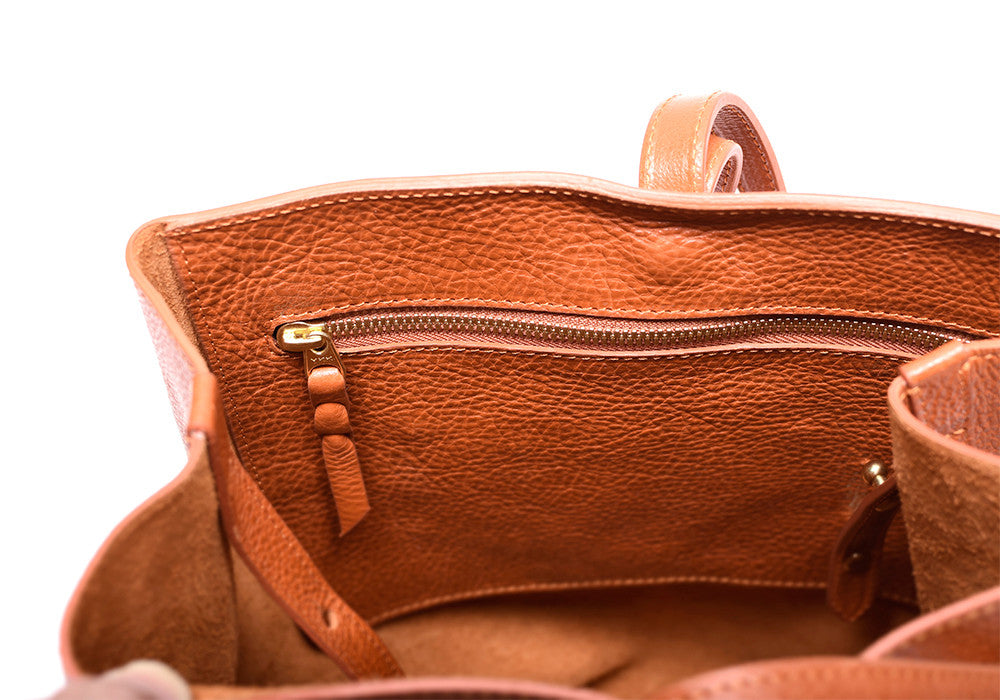 Inner Leather Pocket of The Sling Backpack Orange