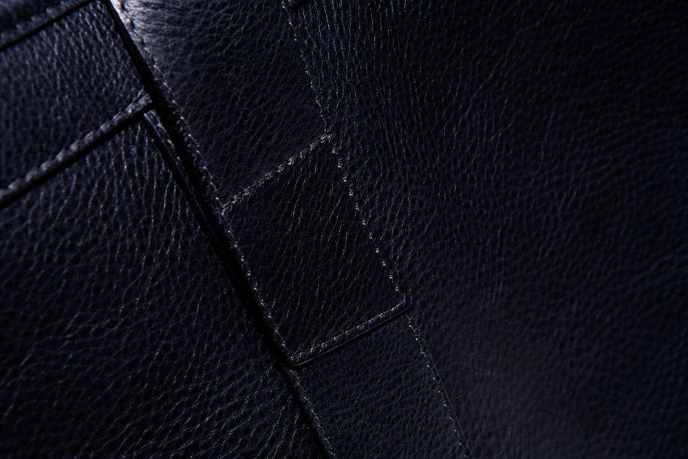 Close Leather Strap of Small Leather Duffle Navy