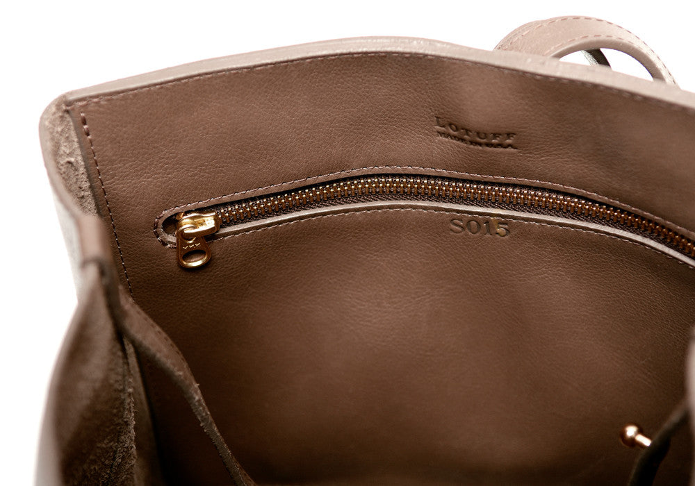 Inner Leather Pocket of The Sling Backpack Clay
