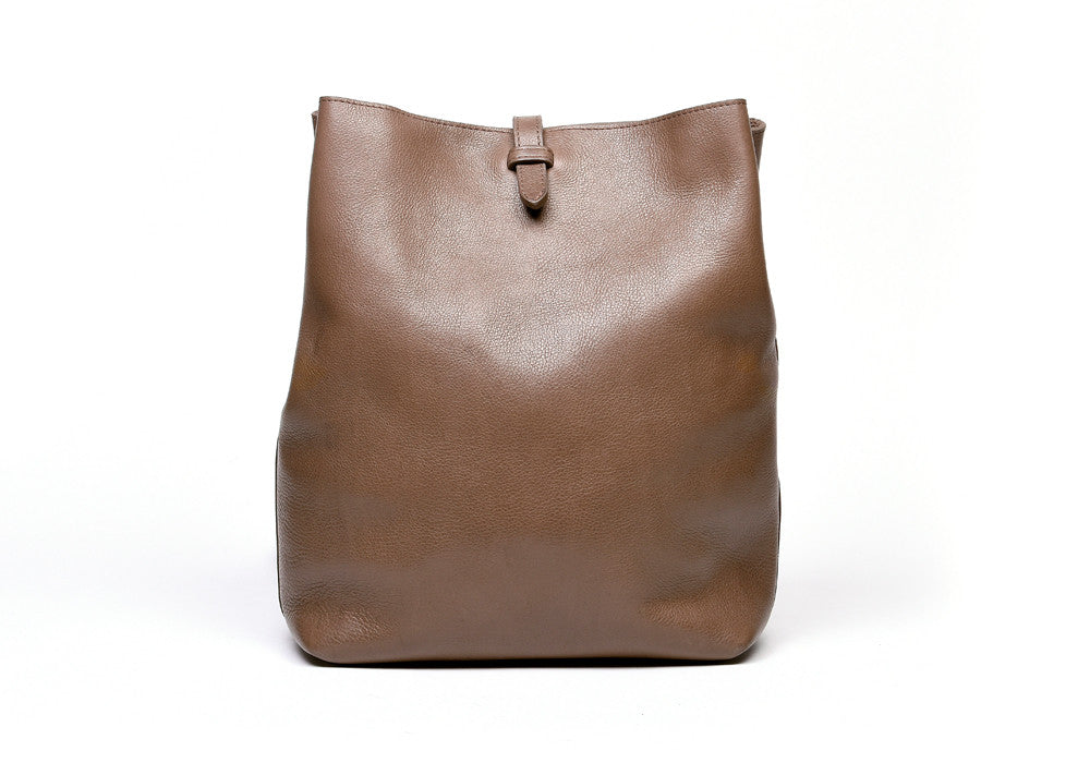The Sling Backpack Clay|Front Leather View