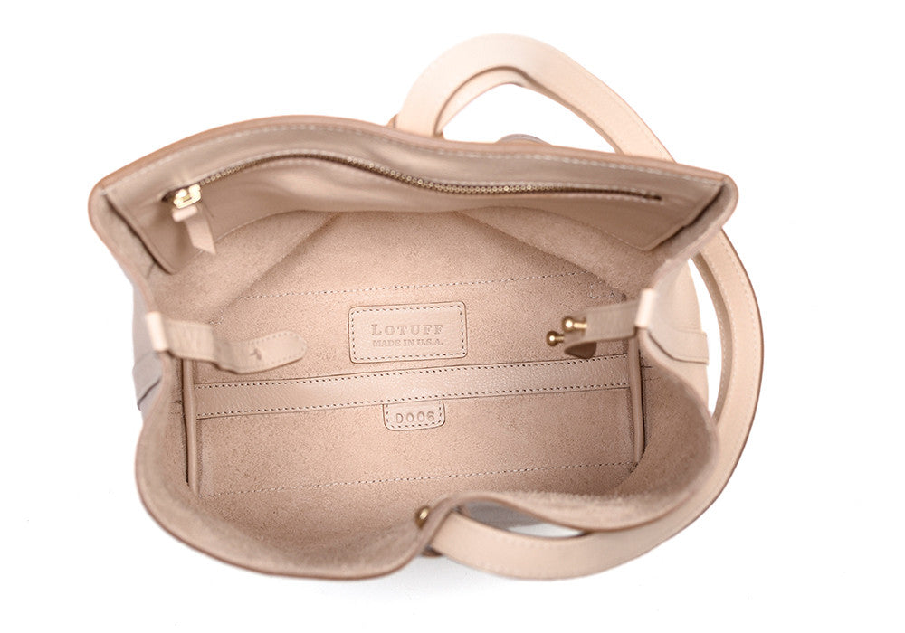 Inner Leather Pocket of The Sling Backpack Natural