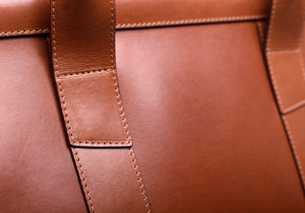 Up Close Leather View of Bridle Duffle Travel Bag Cognac Bridle