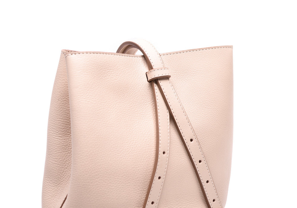 Back Leather Straps of The Mini Sling Backpack Natural