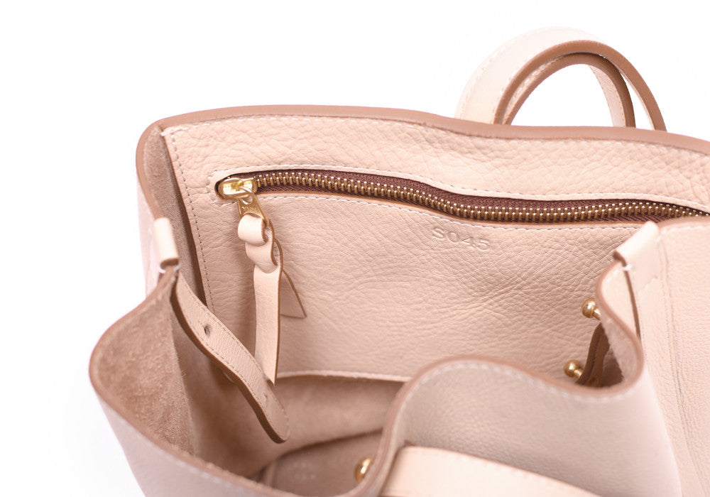 Inner Leather Pocket of The Mini Sling Backpack Natural