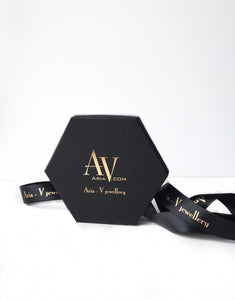 Aria-V branded black and gold embossed gift box