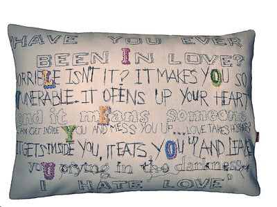 Embroidered 'I HATE LOVE' cushion