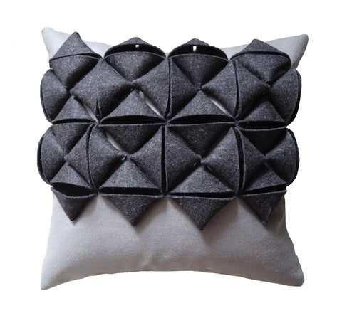 Mixed grey origami parcel cushion