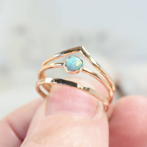 stacking v ring with fire opal ring and hammered band ring