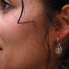 little hoop earrings with lotus dangles