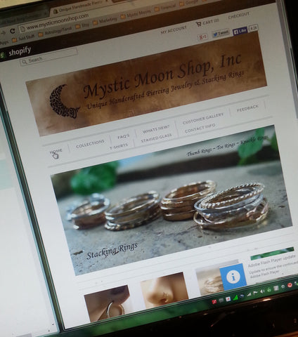 Mystic Moon Shop Web Page on a monitor