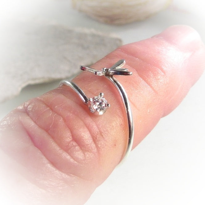 model wearing a sterling silver dragonfly ring