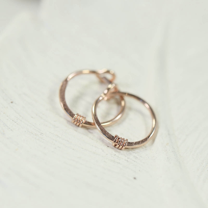 hammered & wrapped tiny hoop earrings in pink gold