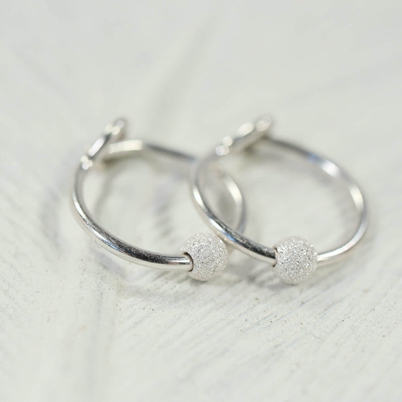 stardust tiny hoop earrings silver