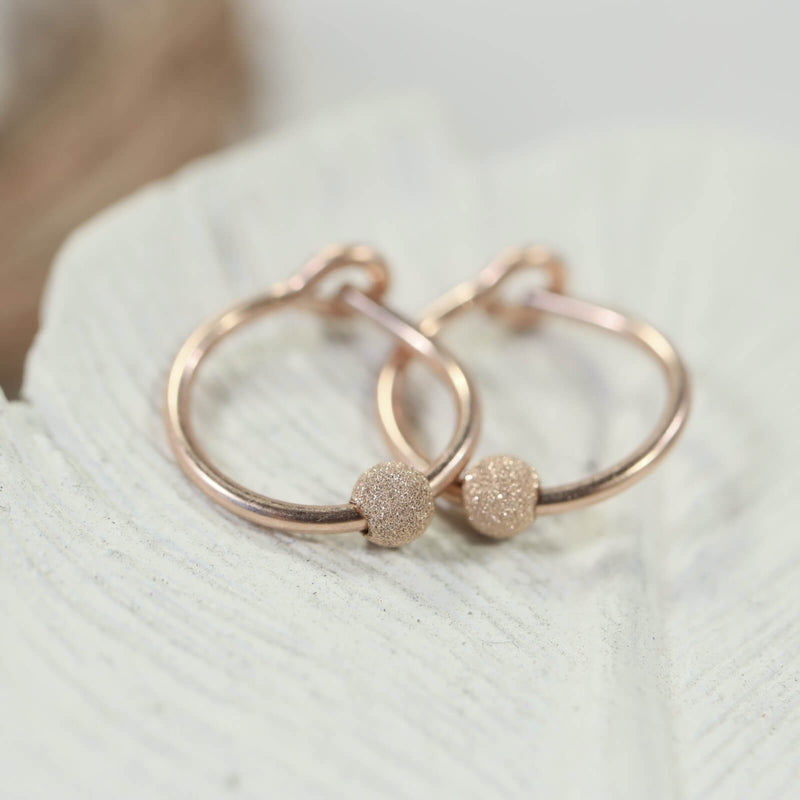 stardust tiny hoop earrings pink gold