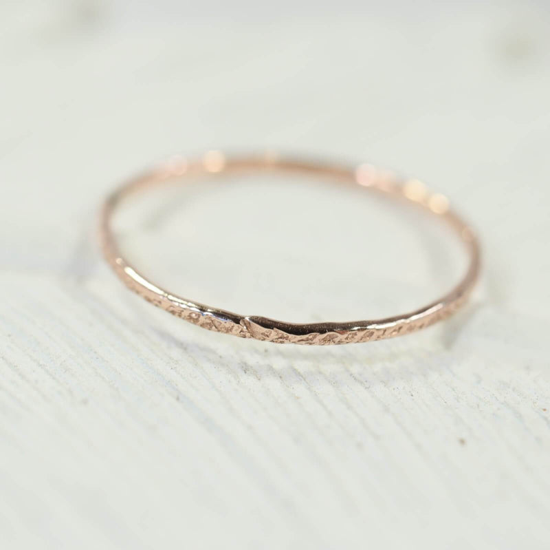 thin band stacking rings pink gold