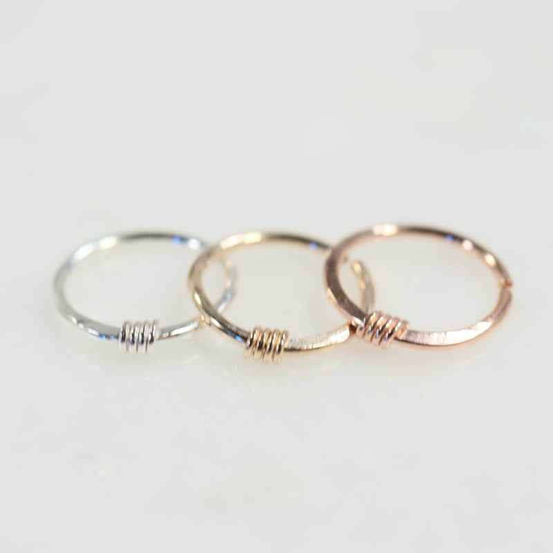 Nose ring hammered & wrapped in silver, gold and pink gold