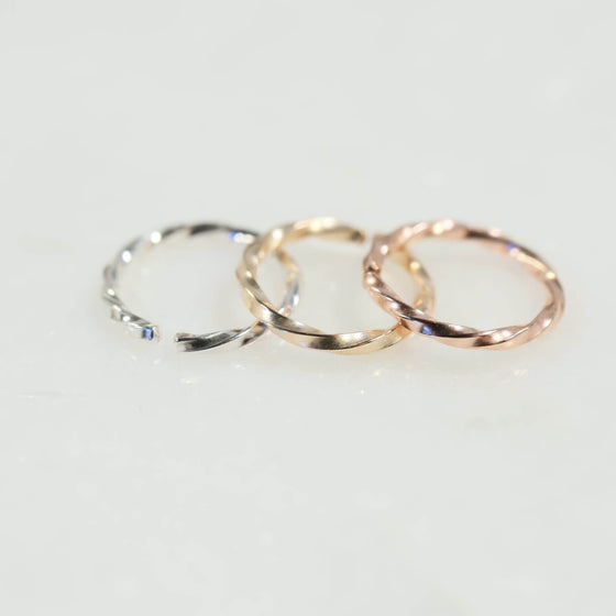 Twist nose rings in silver, gold and pink gold