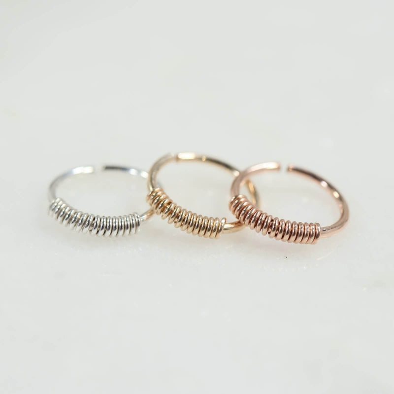 wrapped nose rings in silver, gold and pink gold