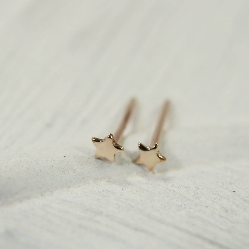teeny tiny star stud earrings gold