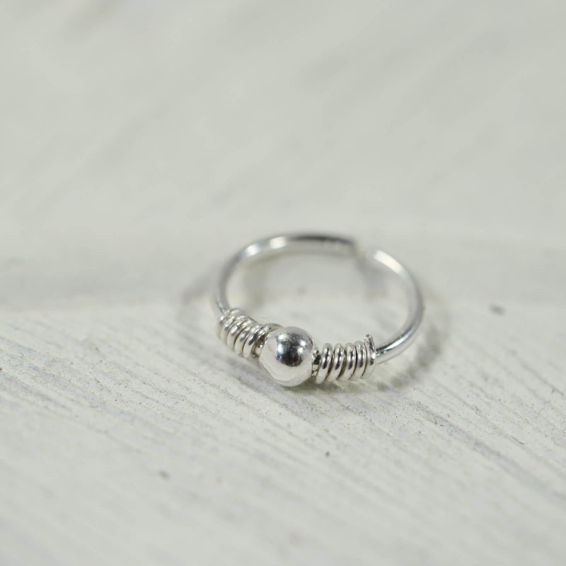 silver beaded and wrapped nose ring
