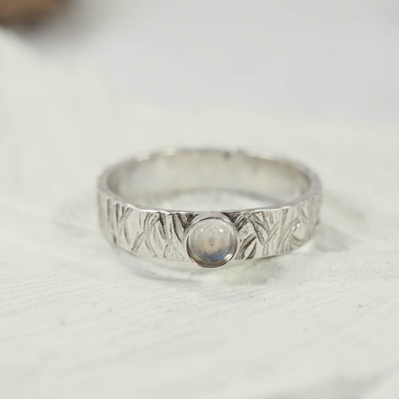 gemstone silver ring with rainbow moonstone