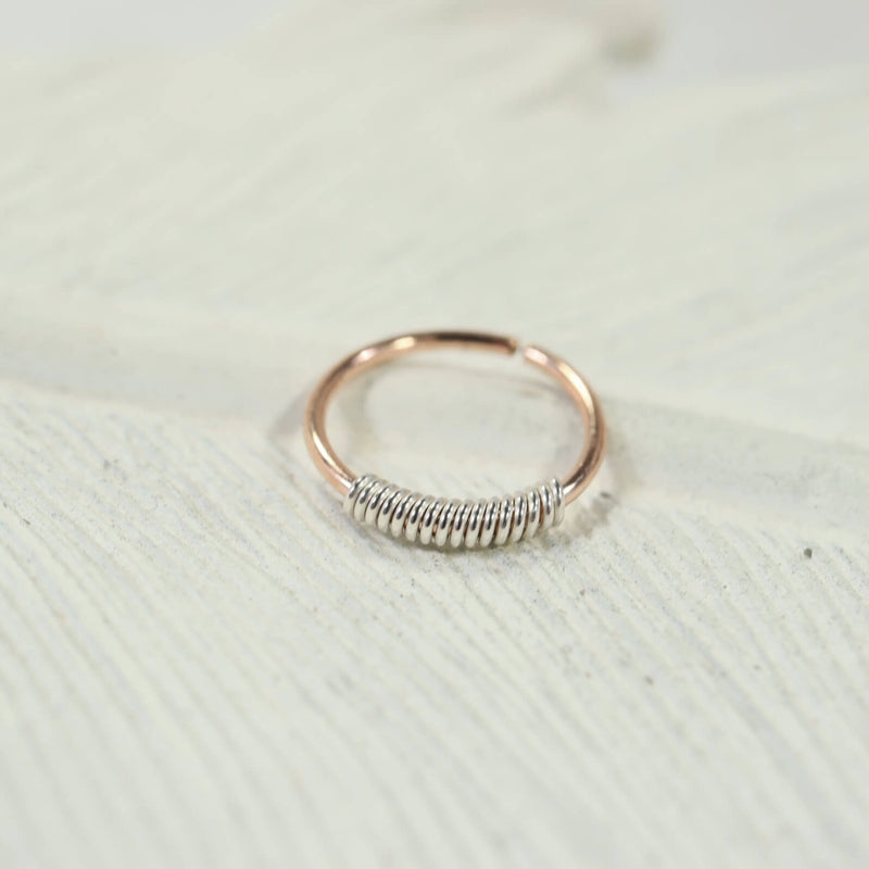 silver wrapped pink gold nose ring